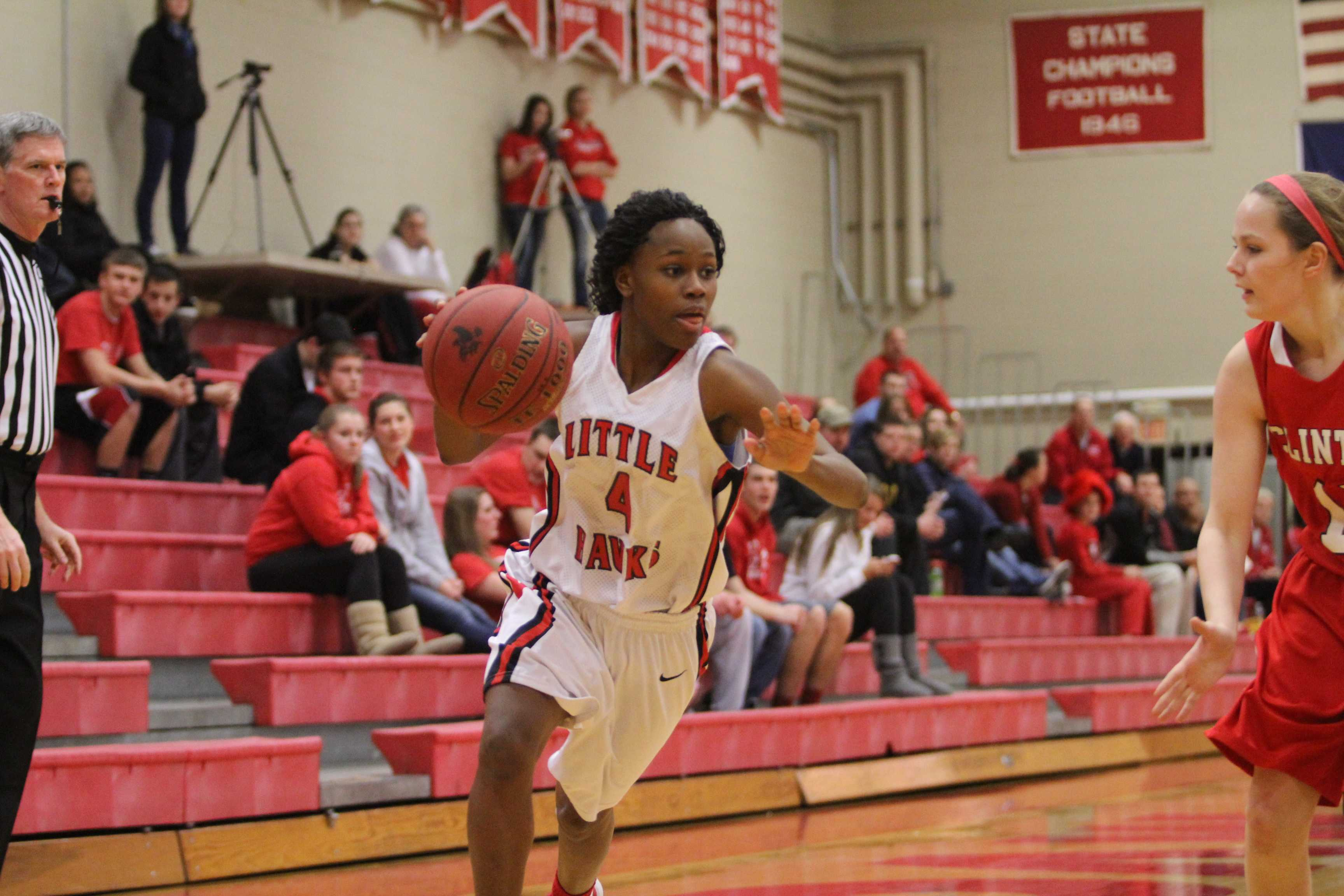 Kiera Washpun '14 drives to the basket during the substate semi-final game against Clinton. Photo by Ryan Young.
