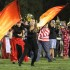 Color Guard performs with the band at the Halloween football game half time show