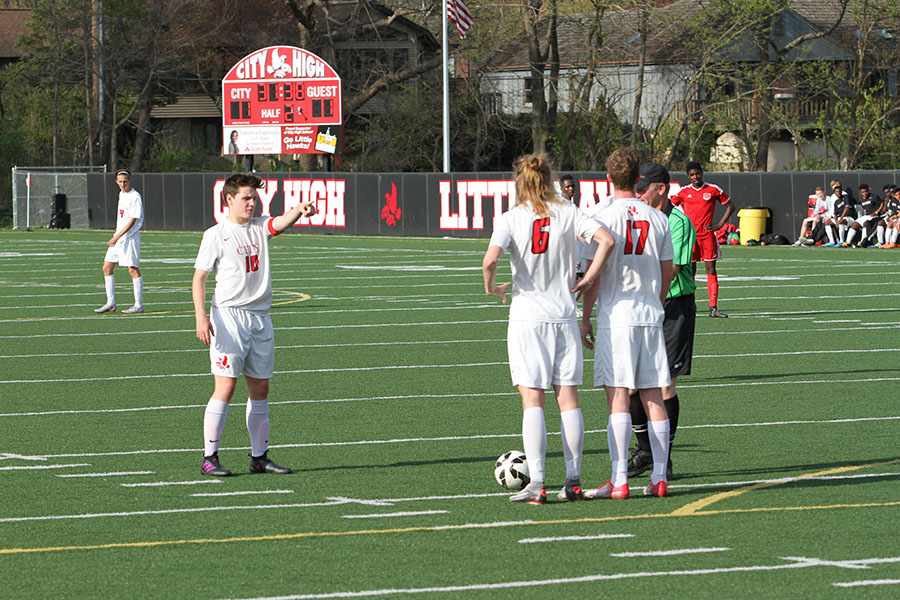 Jackson Meyer '18 lines up his team as he prepares to take a shot.