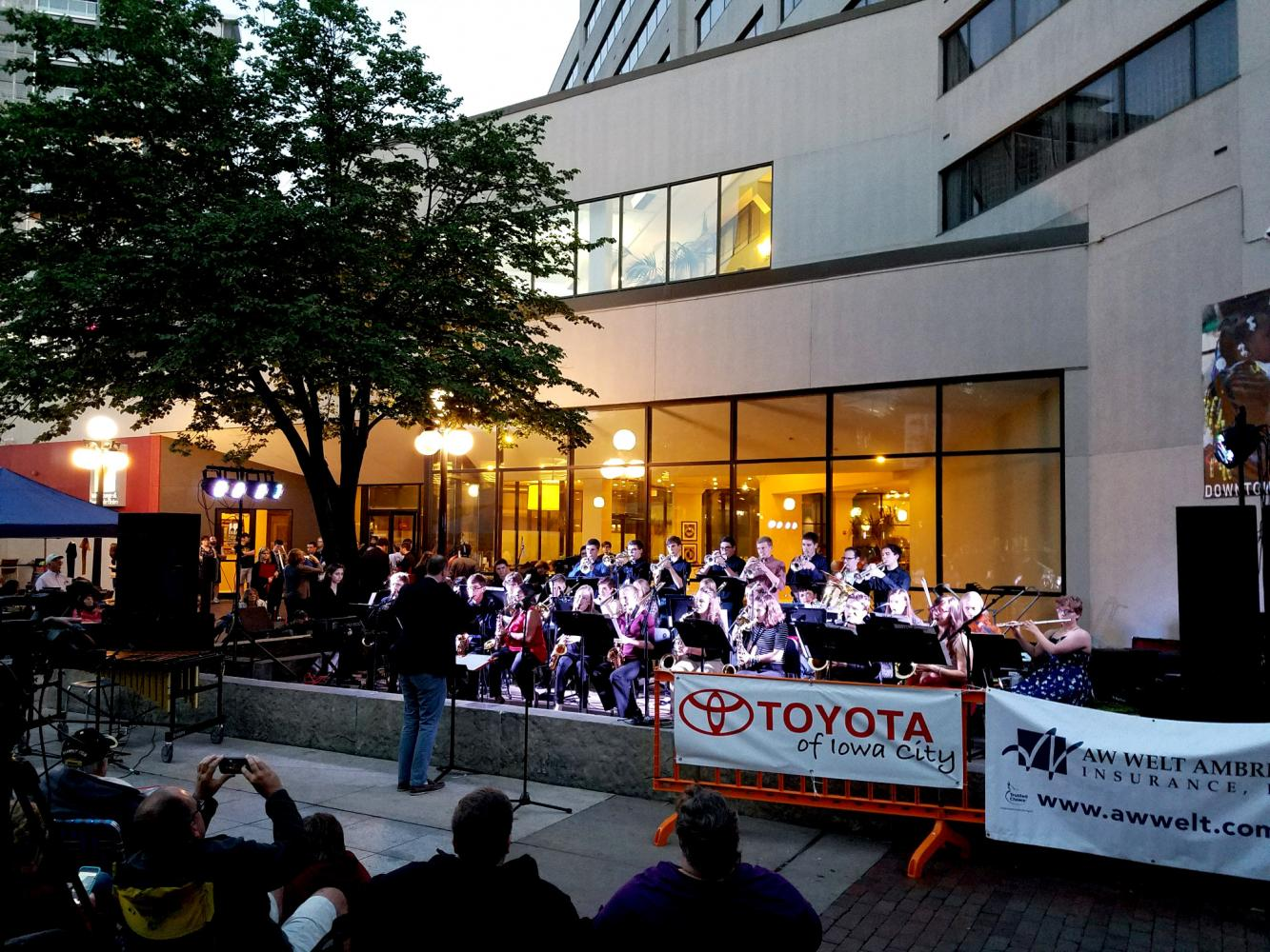 Ryan Arp conducts the jazz bands Friday night on the Pedmall