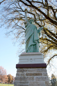 New Lady Liberty Mounted in Front of City