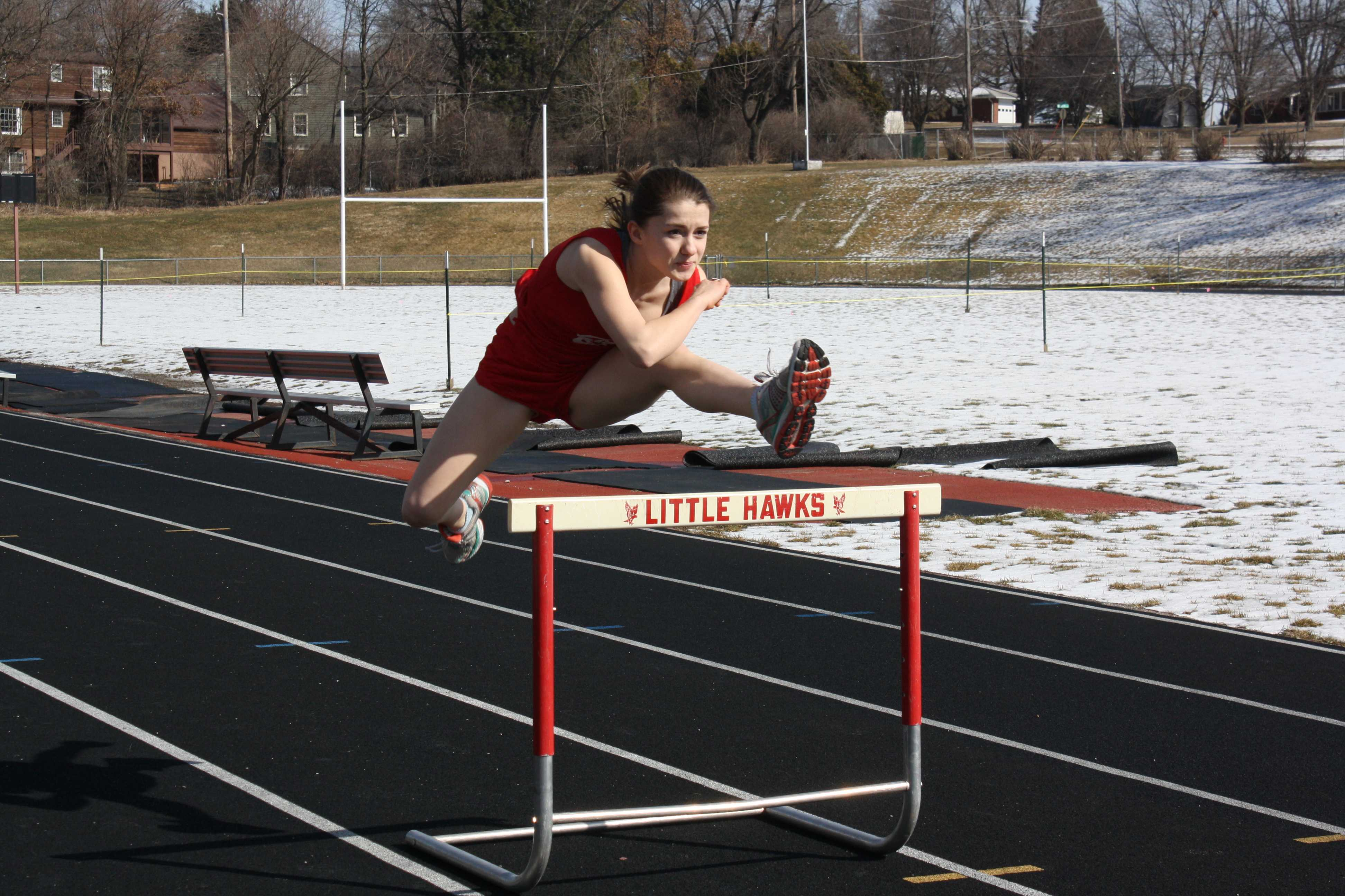 Terra Perez takes a hurdle in stride on the track. Photo by Daniela Perret