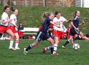 Abby Schroder '12 battles for the ball against Xavier in the 2011 season.  Photo by Renata Stewart