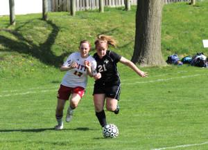 Erin Danielson '13 battles for the ball against Cedar Falls.  Photo by Jake Binggeli.