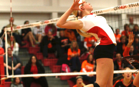 Rylee Price '15 goes up for an attack in the Little Hawk's first round match against CR Prairie.  Photo by Cora Bern-Klug