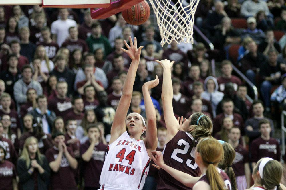 Haley Lorenzen '14 shoots over a Dowling defender in the state semi-final.  Photo by Cora Bern-Klug