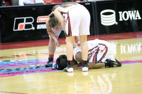 Payton Koenig tries to lift Kierra Washpun after time had expired.