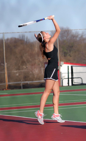 Rebecca Storey serves during her match against Prairie