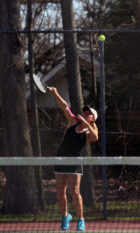 Eve Small serves during her singles match against Prairie