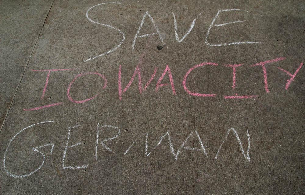 City High students have chalked sidewalk on campus in protest of the announcement that the German language program will be phased out of the ICCSD's class offerings.