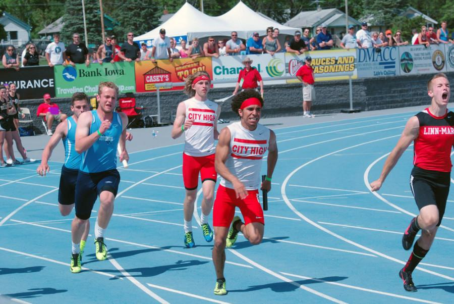 Kole Butler '14 hands off to Bryson Runge '15 in the 4x100 meter relay.