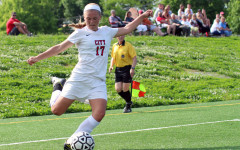 Grace Brown '17 kicks the ball towards goal with all her might