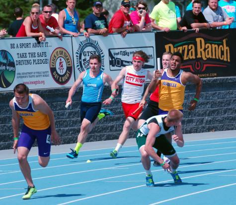 K. Butler sprints the 4x100 meter dash at State alongside Chuck Riley '11, Cory Lindsey '12, and Bryson Runge '11. The team finished in fourth with a time of 42.52.