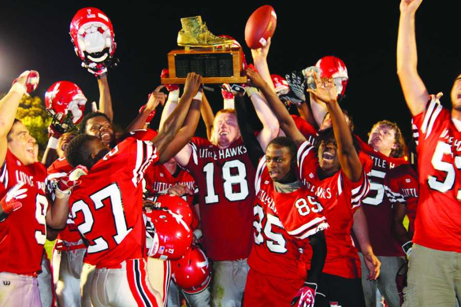 City High football team celebrates after beating West high for the Battle of the Boot.