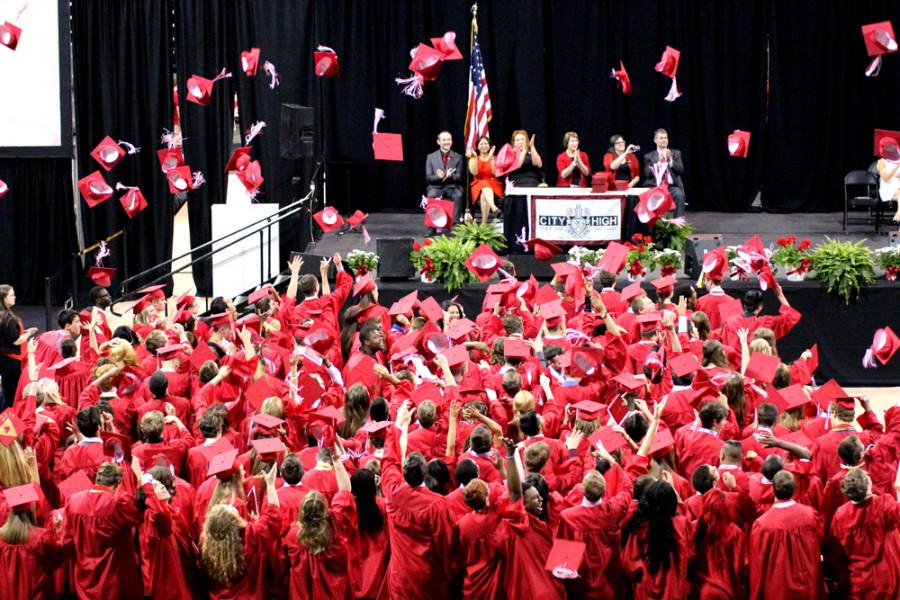 Class of 2014 throwing their caps in celebration.
