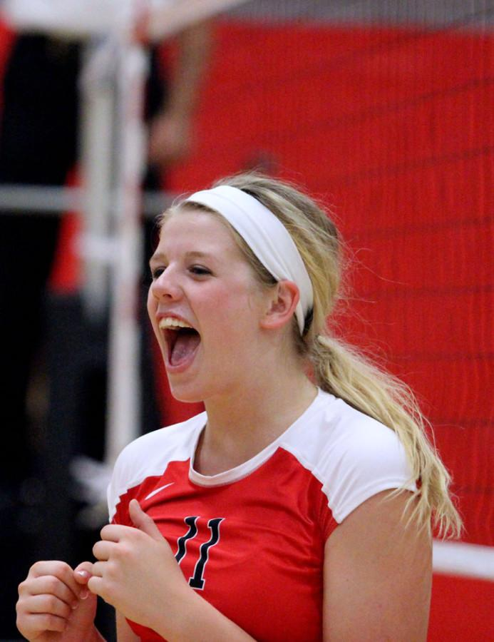 Rylee Price 15 celebrates another spike.