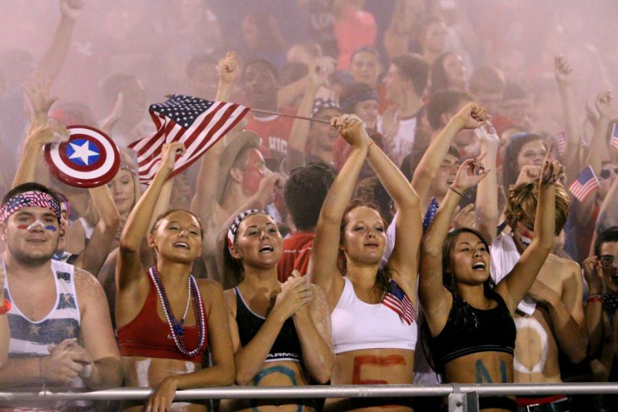 Students throw baby powder in the air during the first home game: USA Night