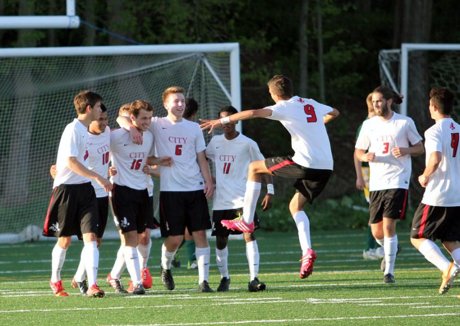 Team+celebrates+after+goal+by+Nicholson