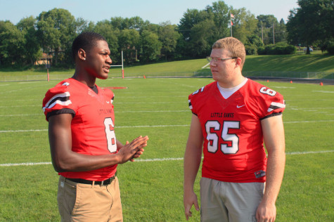 DeJuan McKenny '15 and Eric McDonald '15 discuss strategy for tonight's game against Cedar Falls