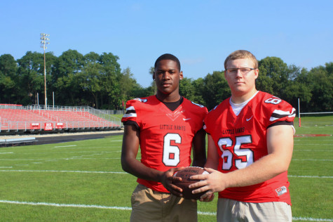 DeJuan McKenny '15 and Eric McDonald '15 pose on Bates Field the morning before the Cedar Falls game