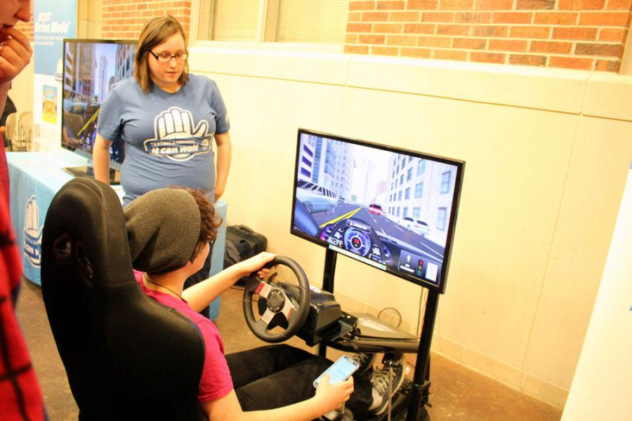 Students+test+their+texting+and+driving+abilities+with+the+%22It+Can+Wait%22+simulator