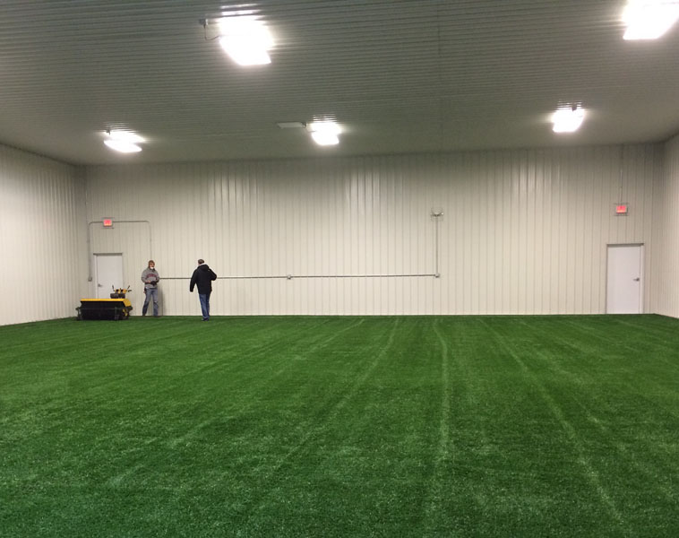 Indoor+preview+of+the+new+hitting+facility+at+City+High.+Workers+are+laying+down+turf+at+this+point.+