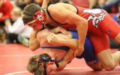Colton Chalupa '15 takes control over a Washington opponent. Chalupa won his match against Cedar Falls at weight 138 with a fall in just over a minute.