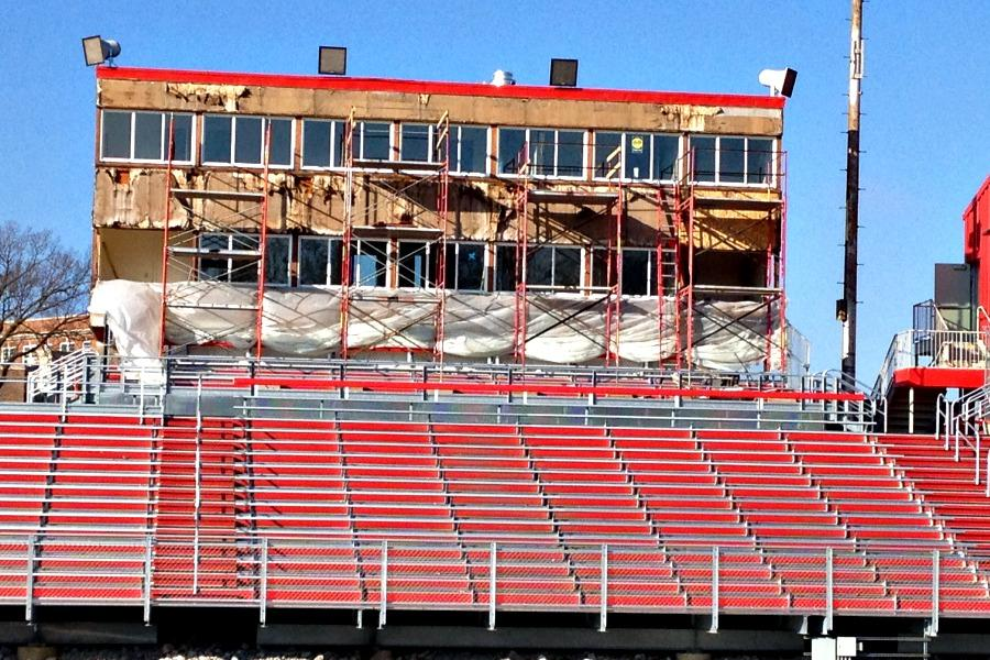 Construction continues on the old press box over Bates Field.