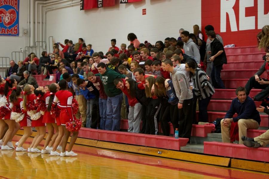 Cheerleaders+get+the+student+section+to+cheer+along.