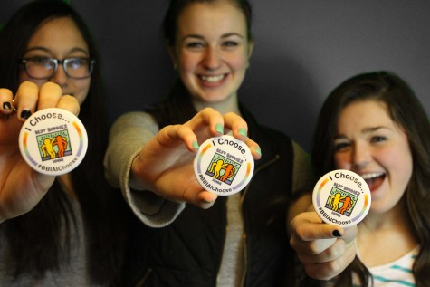Arielle Somadi '15, Maggie Morony '15, and Katrina Scandrett '15 proudly show off their buttons.