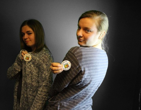 Oliva Peterson '15 and Estie Dillard '17 show off their buttons, they choose not to use the R-word in their everyday conversations.