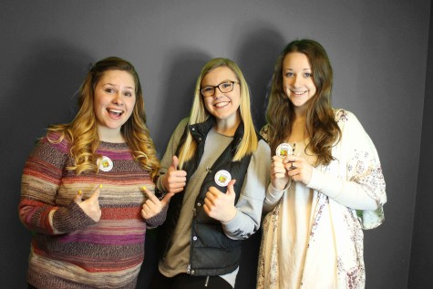 Dacey Messinger '15, Lillie Christopherson '15, and Emma Pradarelli '15 all took the pledge and got their buttons.