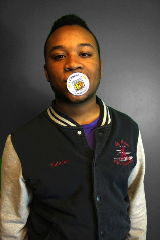 Bj Sullivan '15 uses his button to block the r-word.