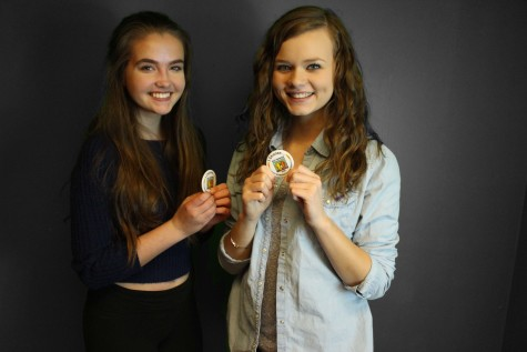 Sofie Lie '17 and Sadie Hobbs '17 show off their buttons right after they signed the pledge for Spread the Word to End the Word day.