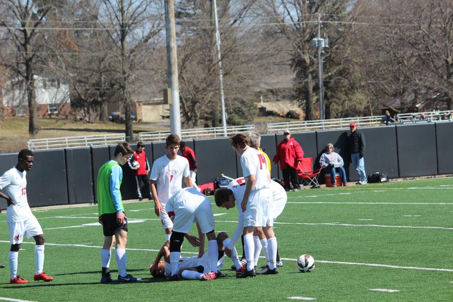 City High team tends to injured player Victor Brown-Rodriguez