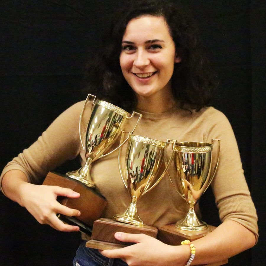 Addie and her trophies