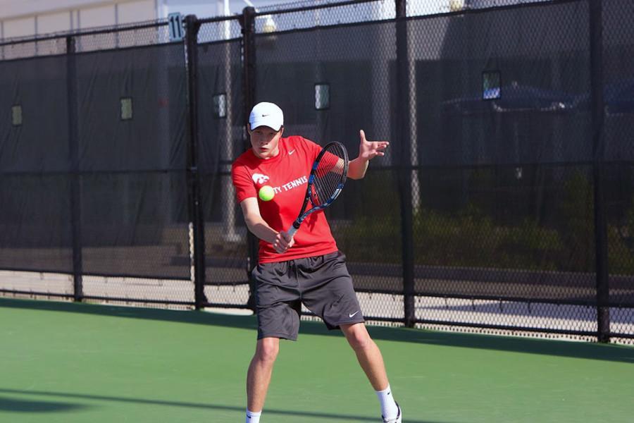 Joe Hoff '17 (1) slices a backhand during his match against Jiung Jung in 2015.