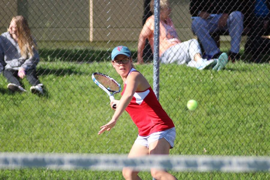 Eve Small '15 winds up a hard forehand against her opponent during Tuesday's match.