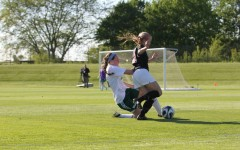 Maddie DePrenger '16 blows by a West High defender
