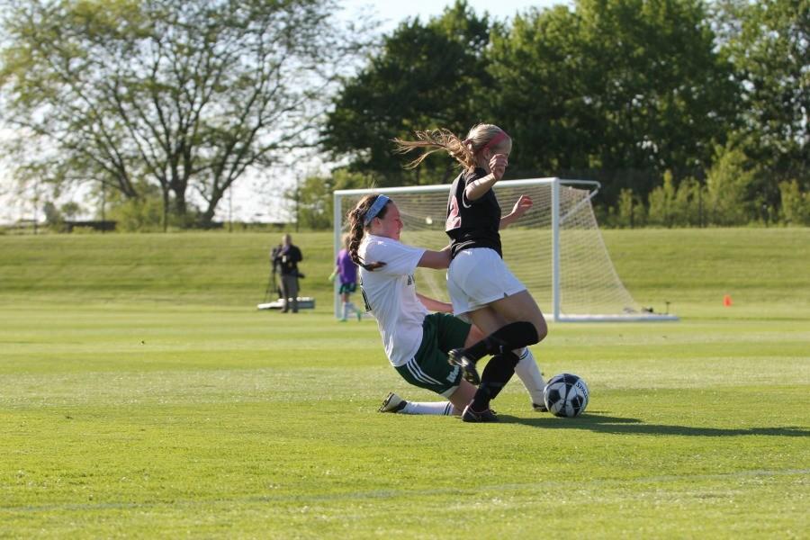 Maddie DePrenger '16 blows by a West High defender