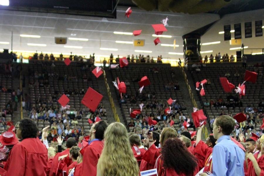 Senior Class of 2015 throw their caps in the air.