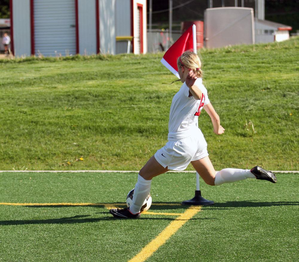 Maddie Deprenger '16 takes a corner kick during a game in 2015.
