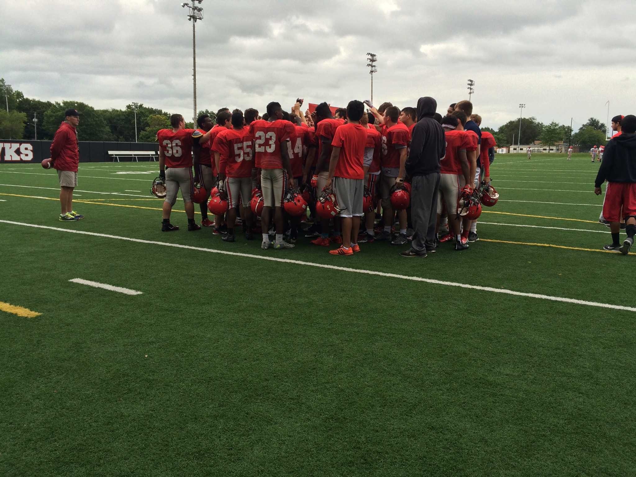 Little Hawks huddle at practice Thursday the 27th.