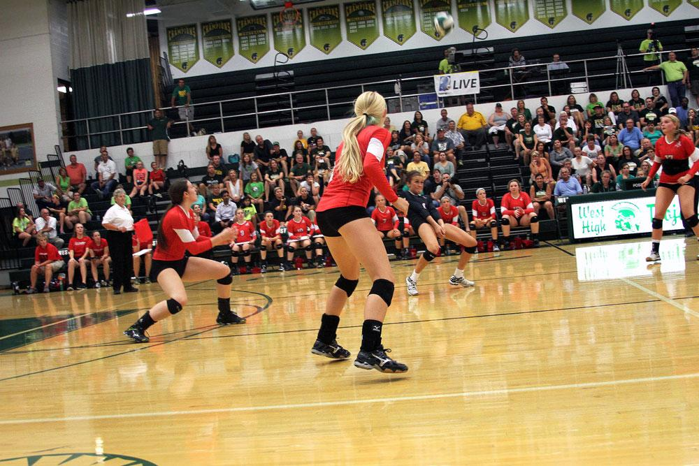 Libero Ashley Smith '16 saves a spike against West.