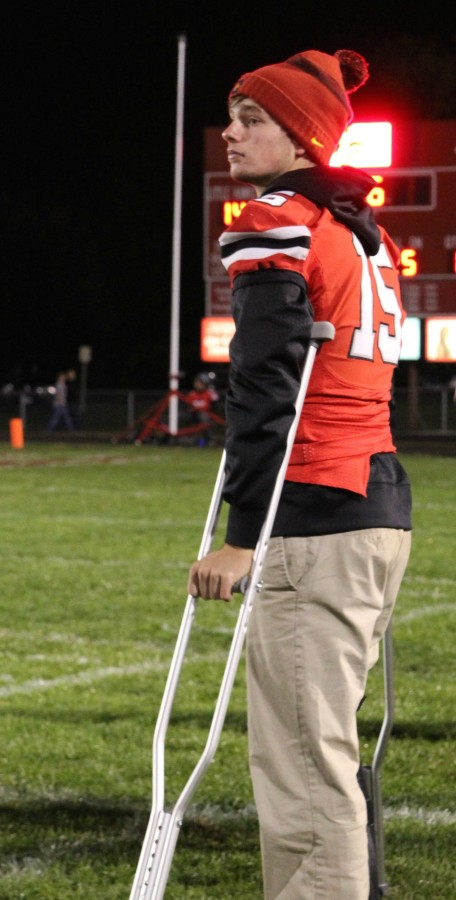 Mitch Wieland 17 watches City High play from the sidelines.