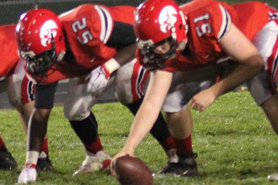 Patrick Henkhaus 16 prepares to snap the ball for City High.