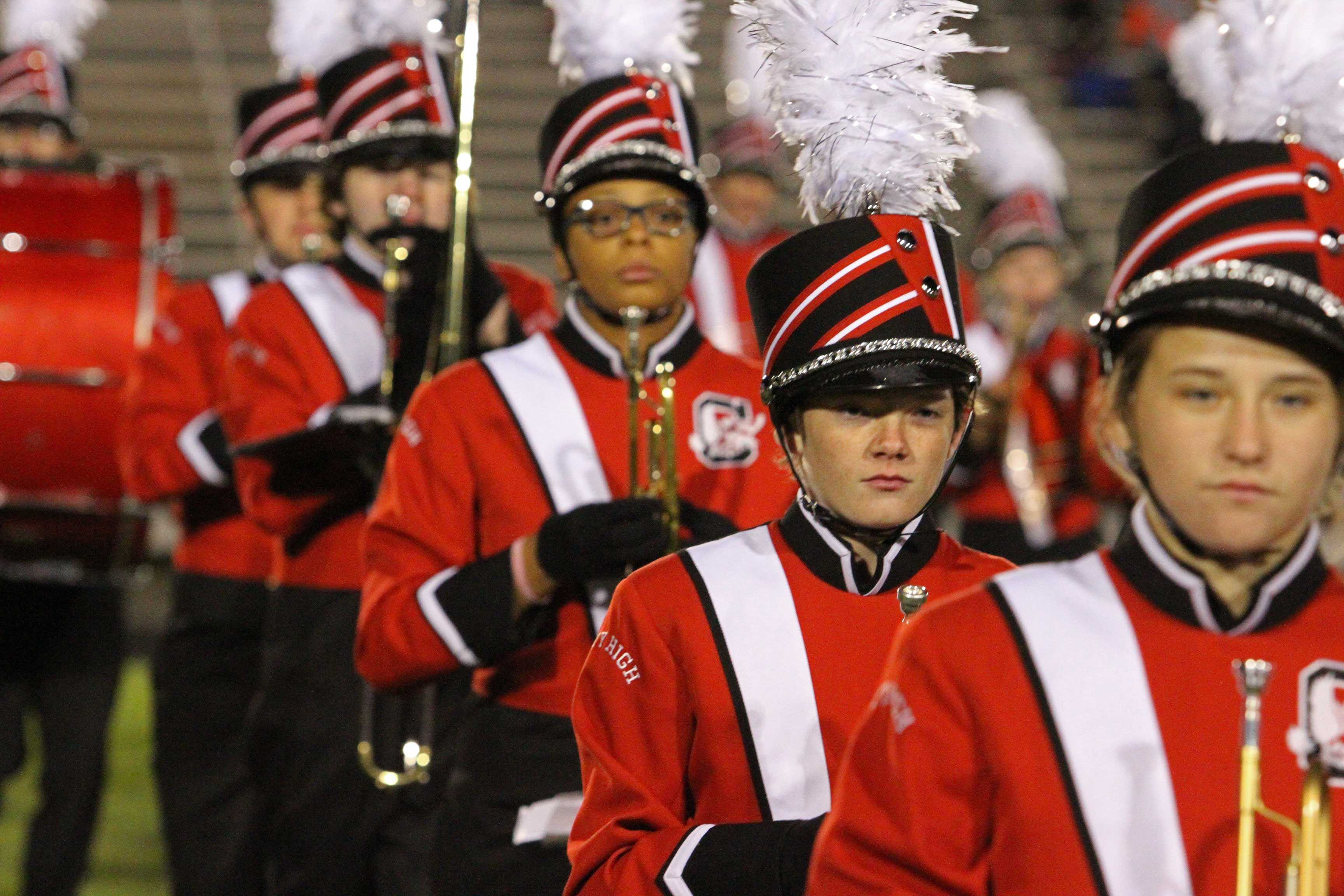 The+Little+Hawk+Marching+Band+march+off+the+field+following+their+last+pregame+performance+of+the+season+on+the+chilly+October+night.