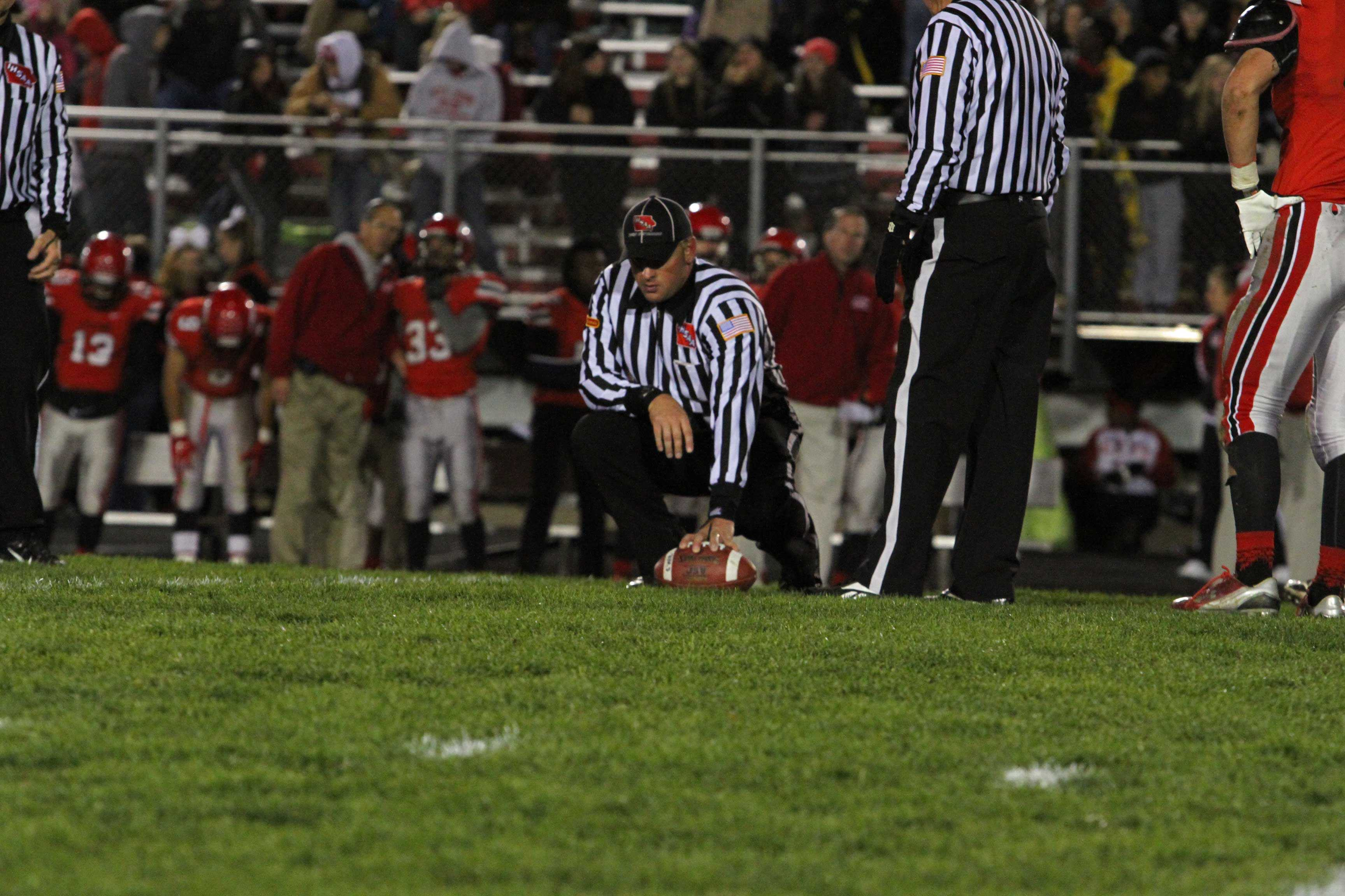 The+City+High+sideline+watches+intently+as+the+officials+prepare+to+spot+Washington%27s+ball+on+second+down.
