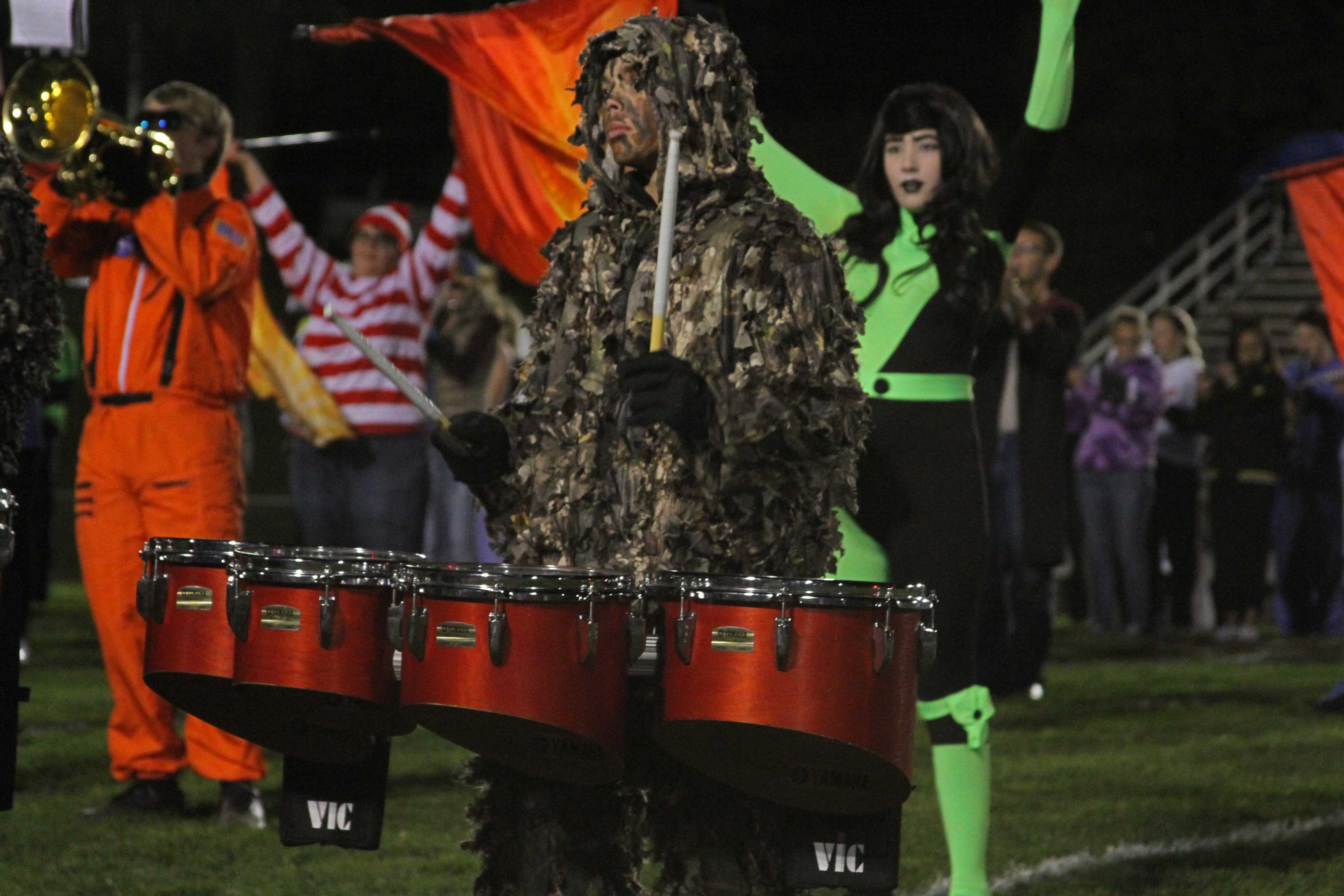 Marching+band+members+performed+their+Halloween+themed+show+in+costume+on+senior+night.
