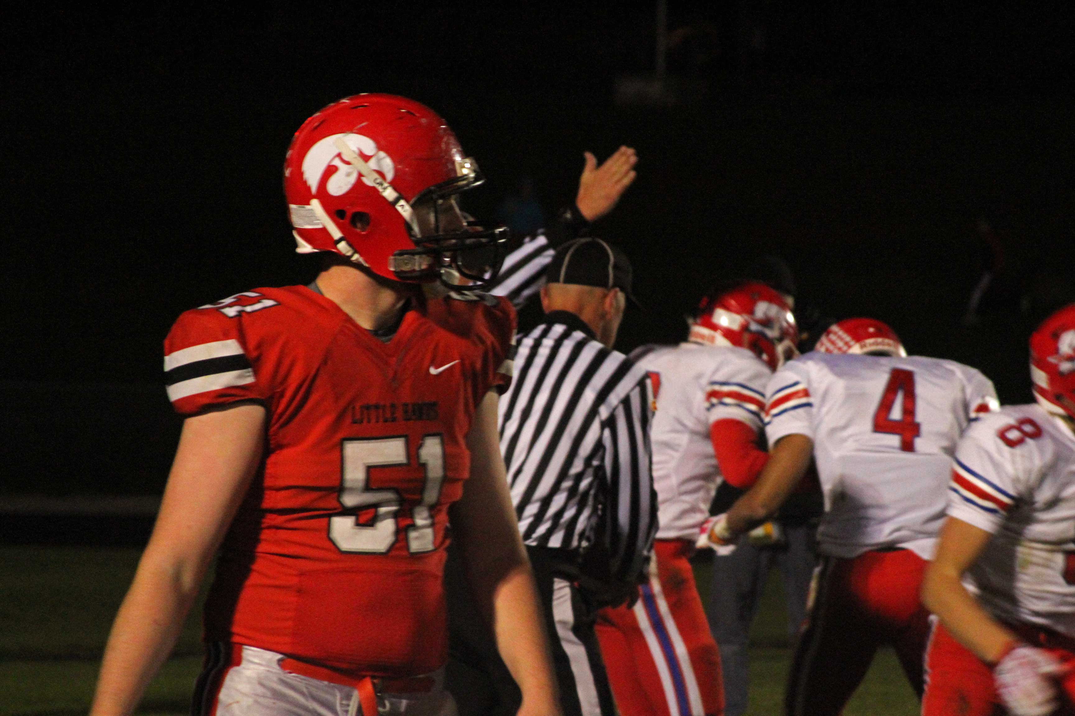 Patrick Henkhaus '16 walks back to the sideline as the officials rule the fumble in the end zone a Warrior ball.
